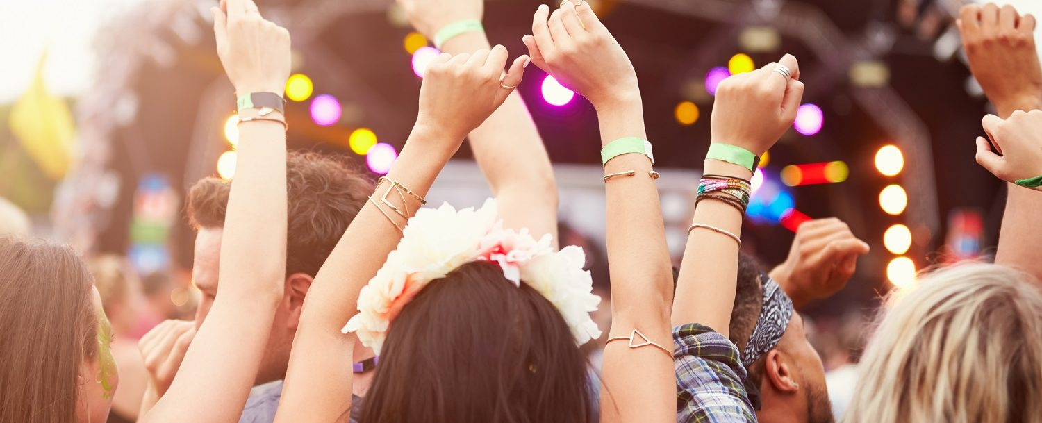 Audience with hands in the air at a music festival