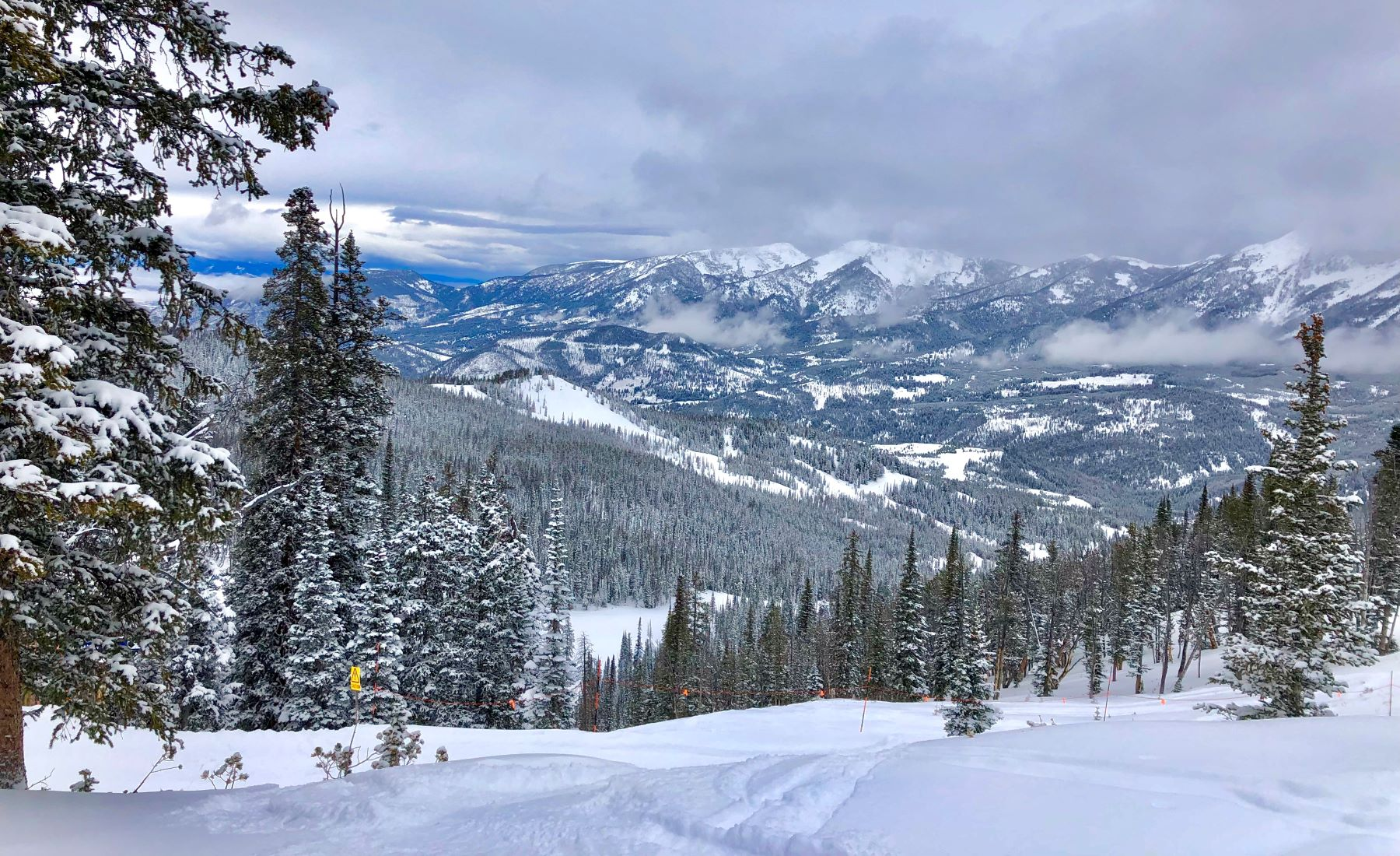 Snow-covered mountains and terrain at Big Sky Resort: Your Big Sky, Montana, Skiing Guide.